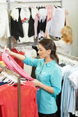 Young woman at apparel shopping — Stock Photo