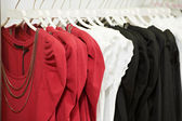 Clothes on hanger in shop — Stock Photo