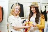 Two Young women at apparel clothes shopping — Stock Photo