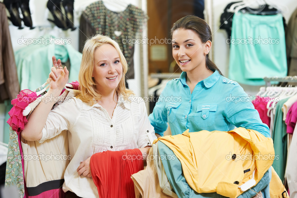 Two Young women at apparel clothes shopping - Stock Image