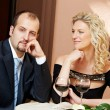 Man and girl with wine at cafe on a date — Foto de Stock