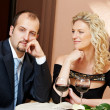 Man and girl with wine at cafe on a date — Stock fotografie