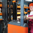 Warehouse forklift worker at work — Stock Photo #9696586