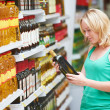 Woman making grocery shopping - Stock Photo