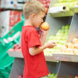 Stock Photo: Child boy making fruits vegetable shopping