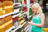 Woman making grocery shopping — Stock Photo