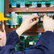 Electrician at safety fuse device replace work — Stock Photo