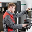 Laborer working with machine tool — Stock Photo