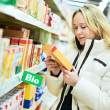 Woman making bio food shopping at grocery store — Stock Photo