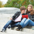 Stock Photo: Two smiling young students outdoors