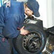 Machanic repairmat tyre balancing adjustment — Stock Photo #9735467
