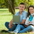 Two smiling young students outdoors — Stock Photo #9735764