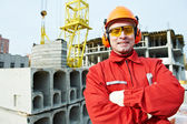 Happy builder worker at construction site — Stock Photo
