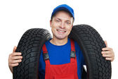 Automobile mechanic with car tire — Stock Photo