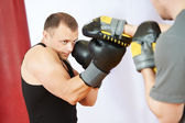 Boxer man at boxing training with punch mitts — Foto de Stock