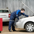 Car mechanic diagnosing auto engine problem — Stock Photo