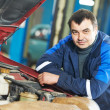 Happy mechanic technician at service station — Stock Photo