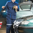 Car mechanic inspecting engine oil level — Stock Photo