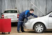 Car mechanic diagnosing auto engine problem — Stock Photo
