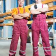 Young manual workers in warehouse — Stock fotografie