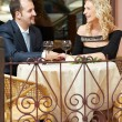man and girl with wine at cafe on a date — Stock Photo