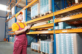 Manual worker inspector in warehouse — Stock Photo