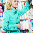 Woman at household chemistry shopping supermarket — Stock Photo