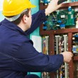 Electrician checking current at power line box — Stock Photo #9963371