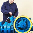 Stock Photo: Machinist tuning elevator brakes mechanism