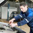 Auto mechanic at work with wrench — Stock Photo #9963446