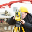 Surveyor works with theodolite - Zdjęcie stockowe