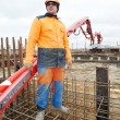 Builder worker at concrete pouring work — Stock Photo #9963531