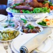 Stock Photo: Roast turkey in dish on dinner table. Focus on foreground