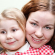 Stock Photo: Mother and little daughter faces close up portrait