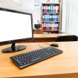 Modern personal computer on desktop in office room — Stock Photo #8743369