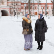 Russian women in winter clothes against Orthodox monastery — Stock Photo #8743376