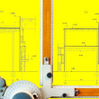 Old-fashioned drawing board with yellow project blueprint - Stock Photo