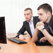 Two business men looking together at computer screen — Stock Photo #8743430