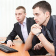 Two business men looking together at computer screen — Stock Photo