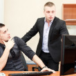 Two business men working together at office on computer — Stock Photo