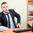 Portrait of a successful young businessman sitting and working — Stock Photo