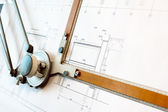 Old-fashioned drawing board with white project blueprint — Stock Photo
