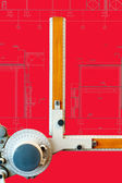 Old-fashioned drawing board with red project blueprint — Stock Photo