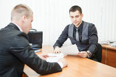 Young business man executives with business documents at work — Stock Photo