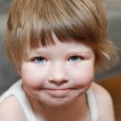 Close-up portrait of small girl with blond hair and blue eyes — Stock Photo
