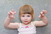 Portrait of small girl with terrifying hands up — Stock Photo