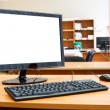 Modern personal computer on desktop in office room - Foto Stock