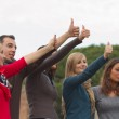 College Students with Thumbs Up — Stock Photo #10134679