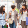 Three Beautiful Young Women doing Shopping - Foto Stock