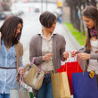 Three Beautiful Young Women doing Shopping - Stock fotografie